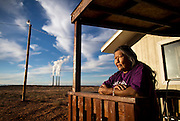 Betty Thompson stands on her porch at her home in Page, Ariz. near the Navajo Generating Station. Thompson's late mother, Sally Young, resisted the station before it was built in the 1970s, which now looms over her backyard.