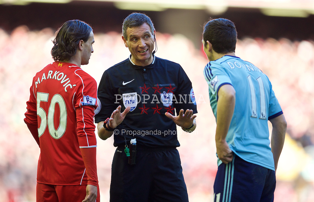 LIVERPOOL, ENGLAND - Saturday, January 31, 2015: Referee Andre Marriner talks to Liverpool's Lazar Markovic and West Ham United's Stewart Downing during the Premier League match at Anfield. (Pic by David Rawcliffe/Propaganda)