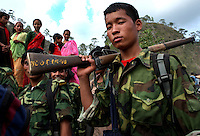 Maoist rebels of the People?s Liberation Army patrol in a remote part of western Nepal on June 22, 2006. The ten-year old conflict in Nepal has claimed an estimated 13,000 lives. (Photo/Scott Dalton)