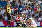 Betsy Hassett (New Zealand) receiving treatment with Monika Mularczyk Referee waiting close by during the FIFA Women's World Cup UEFA warm up match between England Women and New Zealand Women at the American Express Community Stadium, Brighton and Hove, England on 1 June 2019.