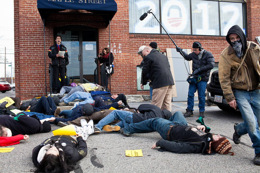 Occupy protesters stage a die in at the offices of Organizing for America, President Obama's re-election organization, on Monday, January 9, 2012 in Manchester, NH. Brendan Hoffman for the New York Times