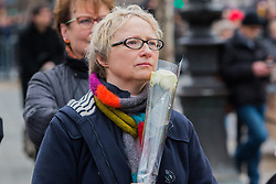 © Licensed to London News Pictures. 10/01/2016. France, Paris. Members of the public at the official ceremony in remembrance of the Charlie Hebdo shootings in 2015. Today January 10th 2016. Photo credit: Hugo Michiels/LNP