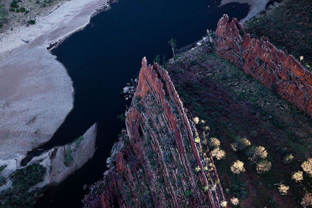 Sheer rock walls drop into the Fink River at Glen Helen Gorge in the West macDonnell Ranges, Central Australia