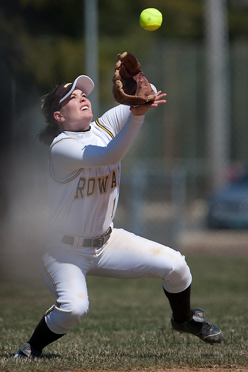 Rowan University junior infielder Ashley Minch (1) catches a fly ball on the edge on the infield.