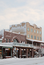 """Snowy Sierra Tavern 2"" - This snow scene of the Sierra Tavern and Commercial Row was photographed in historic Downtown Truckee, CA."