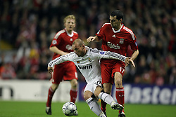 Wesley Sneijder sheilds the ball from Alvaro Arbeloa..Uefa Champions League, First knock-out round, second leg..Liverpool v Real Madrid.Anfield.10.03.09
