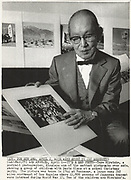 Portrait of Miyatake Toyo with his internment camp photographs.<br />