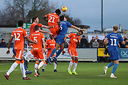 Blackpool attacker Armand Gnanduillet (21) beating AFC Wimbledon defender Will Nightingale (5) to the ball during the EFL Sky Bet League 1 match between AFC Wimbledon and Blackpool at the Cherry Red Records Stadium, Kingston, England on 29 December 2018.