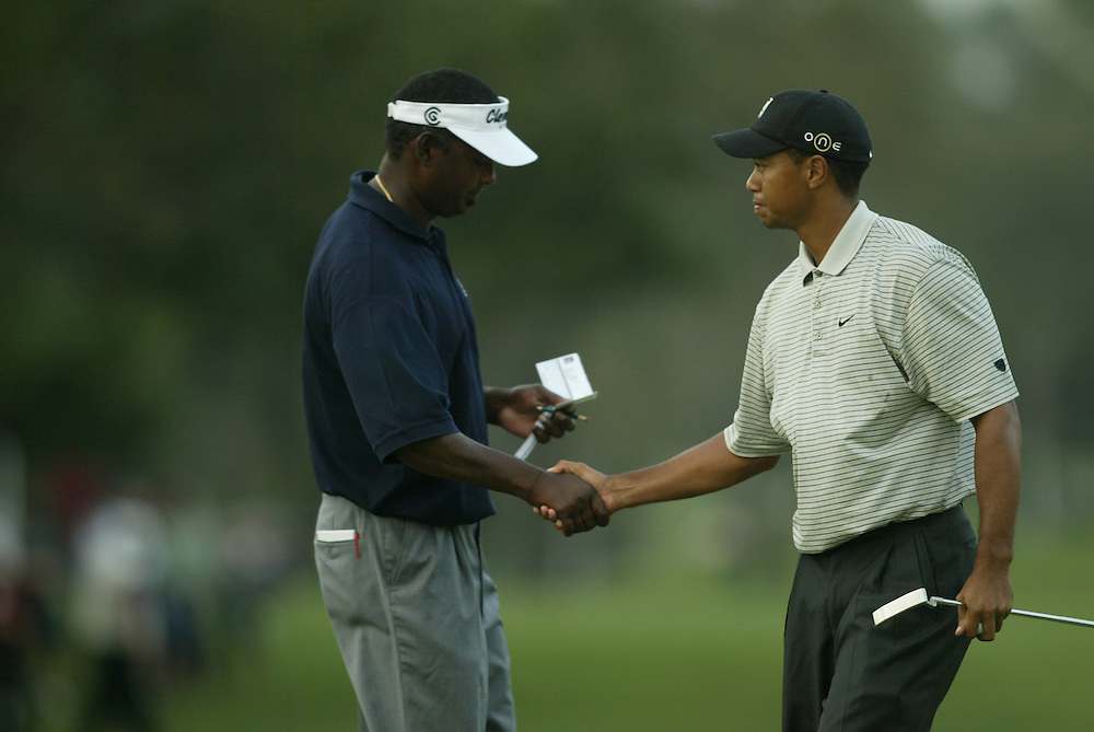 Vijay Singh  Tiger Woods.2003 Tour Championship.First Round.Champions Golf Club.Houston, TX.November 6, 2003..photograph by Darren Carroll