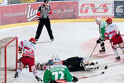 Michal Fikrt (HK Acroni Jesenice, #37) unable to stop the puck but referee invalidated the goal during ice-hockey match between HDD Tilia Olimpija and HK Acroni Jesenice in second game of Final at Slovenian National League, on April 3, 2011 at Hala Tivoli, Ljubljana, Slovenia. (Photo By Matic Klansek Velej / Sportida.com)