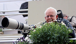 29 April 2011. London, England..Royal wedding day. Ever the consummate pro at hiding behind a bush! Sun photographer Mark Giddings hard at work. Westminster Abbey. .Photo; Charlie Varley.