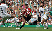 Photo: Paul Thomas.<br /> Glasgow Celtic v Manchester United. Pre Season Friendly. 26/07/2006.<br /> <br /> Chris Eagles (C) of Manchester has a shot at goal.
