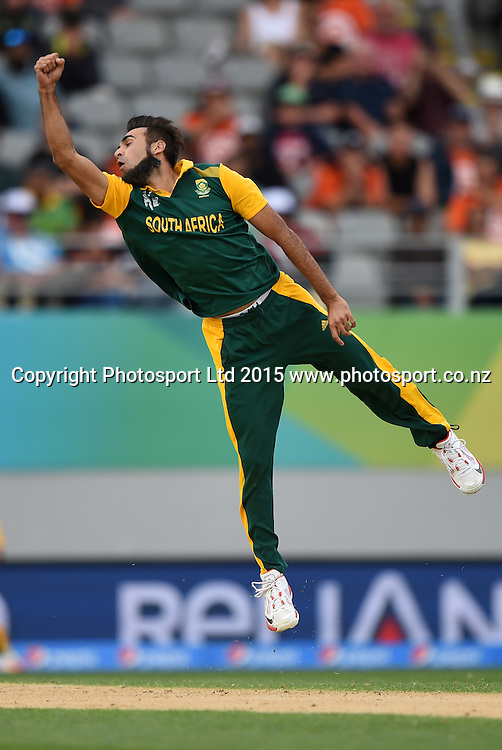 South African bowler Mohammad Imran Tahir dives to field the ball off his own bowling during the ICC Cricket World Cup 2015 match between South Africa and Pakistan at Eden Park, Auckland. Saturday 7 March 2015. Copyright Photo: Andrew Cornaga / www.Photosport.co.nz
