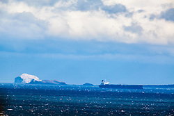 Bass Rock and ship on the River Forth, as seen from the A921 near Burntisland, Fife.