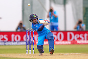 India womens cricket Poonam Raut is bounced by England womens cricket Katherine Brunt  during the ICC Women's World Cup match between England and India at the 3aaa County Ground, Derby, United Kingdom on 24 June 2017. Photo by Simon Davies.