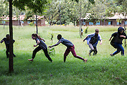 The team of volunteers practise some energising games in preparation for their school training session with pupils at Endagikot school as part of the ICS Raleigh SWASH (school water, sanitation and hygiene plan) project. Mbulu, Manyara district, Tanzania. Working in partnership with the Diocese of Mbulu Development Department (DMDD); part of Caritas Tanzania.