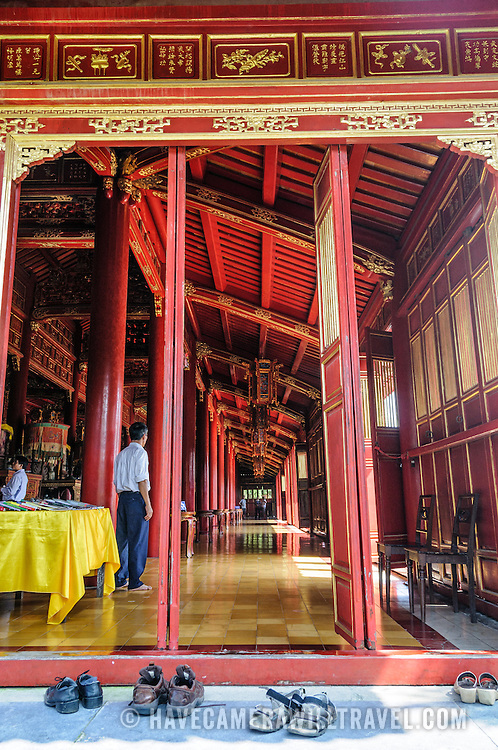 A side entrance of the To Mieu Temple at the Imperial City in Hue, Vietnam. A self-enclosed and fortified palace, the complex includes the Purple Forbidden City, which was the inner sanctum of the imperial household, as well as temples, courtyards, gardens, and other buildings. Much of the Imperial City was damaged or destroyed during the Vietnam War. It is now designated as a UNESCO World Heritage site.