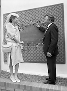 """Best Dressed Lady at Phoenix Park Races.1984..11.08.1984..08.11.1984.11th August 1984..A competition,sponsored by V'Soske Joyce,was held at the Phoenix Park Racecourse,Dublin.The prize of a hand tufted rug was awarded to the """"Best Dressed Lady"""" on Ladies Day at the racecourse. The eventual winner was Brianne Leary from Los Angeles,California..Picture taken as Mr Michael Dixon,Director, V'Soske Joyce Ltd,Oughterard,Galway (Sponsor) points out the intricate design of the hand tufted rug to Ms Brianne Leary, the winner of the """"Best Dressed Lady"""" competition."""