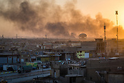Smoke billows as a group of Islamic State fighters launch a counter attack in a liberated neighbourhood in Mosul, setting fire to houses and causing thousands of civilians to flee in fear of a resurgence of the terror group.