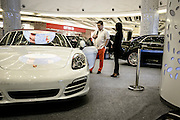 JAKARTA; TUESDAY, NOVEMBER 11, 2014; INDONESIA ECONOMIC RISING: A customer looks at a supercar at the Baywalk Mall atrium in North of Jakarta, Indonesia, Tuesday, November 11, 2014.