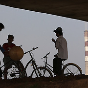 Boys hang around under a bridge near the coal-powered electricty plant in Phai Lai, about 70 kilometers east of Hanoi, Vietnam, 14 September, 2007.