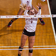 26 August 2016: The San Diego State Aztecs took on the Marist Red Foxes to open up the season.  OH Hannah Turnlund (7) goes up for a block against Marist in the first set. The Aztecs swept the Red Foxes 3-0 in their opening match of the Aztec Invitational at Peterson Gym on the campus of SDSU. www.sdsuaztecphotos.com
