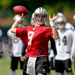 Jul 26, 2013; Metairie, LA, USA; New Orleans Saints quarterback Drew Brees (9) throws a pass during the first day of training camp at the team facility. Mandatory Credit: Derick E. Hingle-USA TODAY Sports