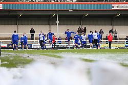 The Rochdale squad warm up on a snowy pitch - Photo mandatory by-line: Matt McNulty/JMP - Mobile: 07966 386802 - 17.01.2015 - SPORT - Football - Rochdale - Spotland Stadium - Rochdale v Crawley Town - Sky Bet League One