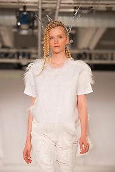 © Licensed to London News Pictures. 31/05/2014. London, England. Collection by Gemma Kearins from the University of Salford. Graduate Fashion Week 2014, Runway Show at the Old Truman Brewery in London, United Kingdom. Photo credit: Bettina Strenske/LNP