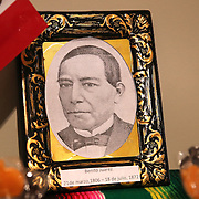 "A photo of Benito Juarez is seen during the celebration of Day of the Dead or ""Día de los Muertos"" at the Mexican Consulate in Orlando, Florida on Saturday, November 2, 2013. Dia de los Muertos is a Latin holiday celebrating friends and family members who have died. Traditions include building private altars called ofrendas to honor the deceased using sugar skulls, marigolds, and the favorite foods and beverages of the departed and visiting graves with these as gifts. (AP Photo/Alex Menendez)"