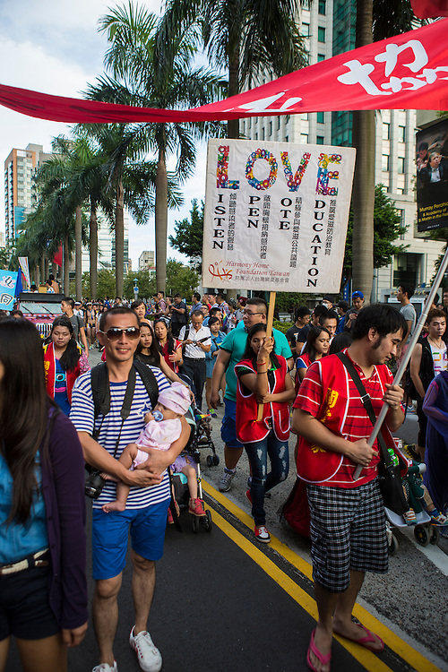 Members of the Harmony Home Foundation, a charity that cares for children and adults with HIV, take part in Taipei's Pride festival.
