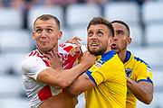 Charlie Wyke (#9) of Sunderland AFC (left) and Luke O'Neill (#2) of AFC Wimbledon grab each other before competing for a header during the EFL Sky Bet League 1 match between Sunderland and AFC Wimbledon at the Stadium Of Light, Sunderland, England on 24 August 2019.