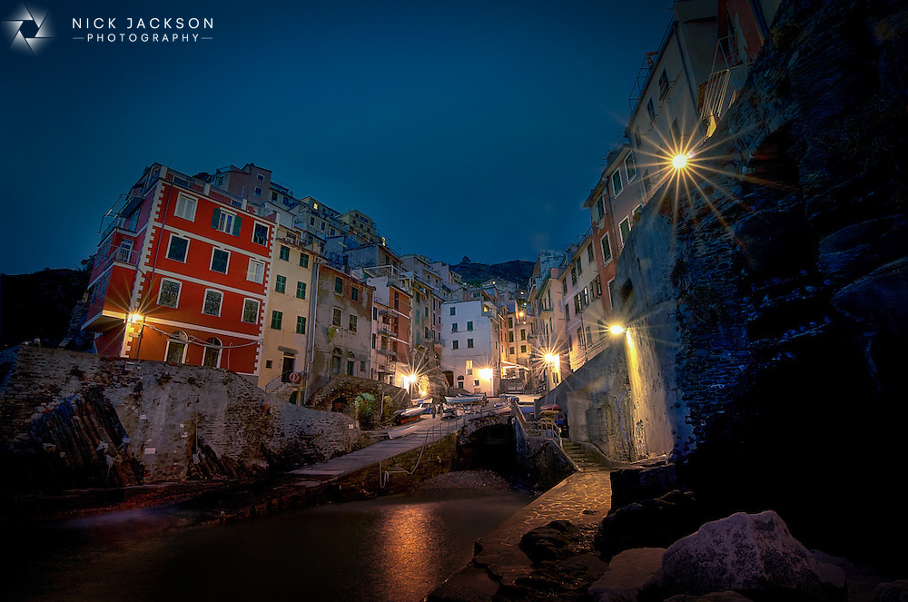 Beautiful in daylight, stunning at night, Riomaggiore is one of the  five Italian fishing villages that makes up the Cinque Terre on Italy's Adriatic coastline.<br /> <br /> It's a quiet fishing village with rainbow coloured houses and incredible seafood.<br /> <br /> Oh and I fell into the ocean trying to get this shot...
