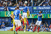 Portsmouth Defender, Christian Burgess (6) wins a header during the Carabao Cup match between Portsmouth and AFC Wimbledon at Fratton Park, Portsmouth, England on 14 August 2018.