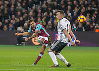 Football - 2016 / 2017 Premier League - West Ham United vs. Manchester United<br /> <br /> A late firt half curling effort from Manuel Lanzini of West Ham forces David De Gea of Manchester United into a fine save at The London Stadium.<br /> <br /> COLORSPORT/DANIEL BEARHAM