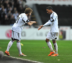Swansea City's Jonathan de Guzman comes off for Swansea City's Jose Alberto Canas - Photo mandatory by-line: Alex James/JMP - Tel: Mobile: 07966 386802 08/02/2014 - SPORT - FOOTBALL - Swansea - Liberty Stadium - Swansea City v Cardiff City - Barclays Premier League