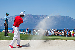 July 15, 2018 - Stateline, Nevada, U.S - Hall of Fame wide receiver, JERRY RICE, hits out of a sand trap on the 17th hole during the 29th annual American Century Championship at the Edgewood Tahoe Golf Course at Lake Tahoe, Stateline, Nevada, on Sunday, July 15, 2018. (Credit Image: © Tracy Barbutes via ZUMA Wire)