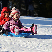 Young children enjoy sledding in Central Park after New York City was hit with over 7 inches of snow during its first winter storm of the year. Central Park, Manhattan, New York, USA. 4th January 2014 Photo Tim Clayton