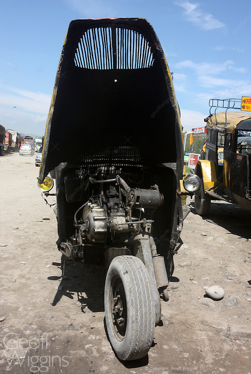 Vintage Bajaj Tempo Tricycle motor rickshaw bus under repair in Jammu, India