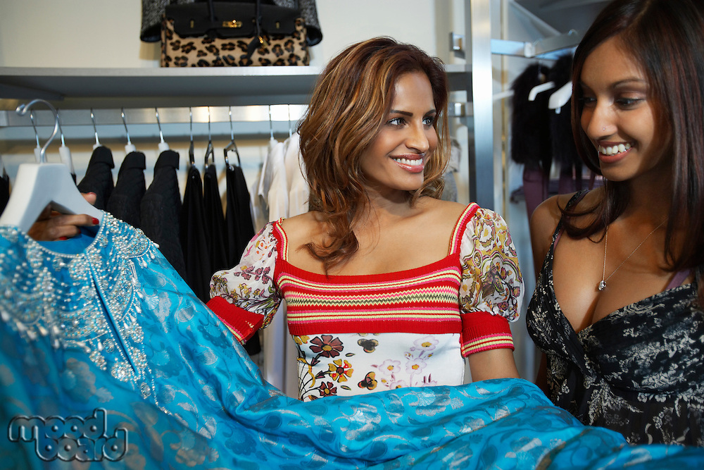 Two women in in clothes shop