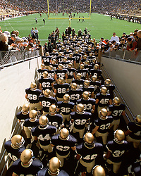 The Notre Dame Football Team takes the field at Notre Dame Stadium.