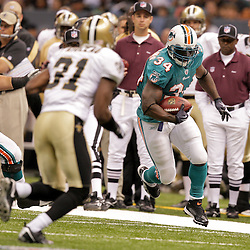 2009 September 03: Miami Dolphins running back Ricky Williams (34) runs as New Orleans Saints safety Pierson Prioleau (31) pursues the play during a preseason game between the Miami Dolphins and the New Orleans Saints at the Louisiana Superdome in New Orleans, Louisiana.