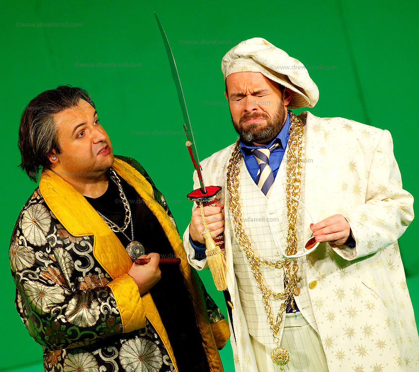 Picture shows : Tiziano Bracci as Mustafa (l) and Adrian Powter as Taddeo (r),.Picture  ©  Drew Farrell Tel : 07721 -735041..A new Scottish Opera production of  Rossini's 'The Italian Girl in Algiers' opens at The Theatre Royal Glasgow on Wednesday 21st October 2009..(Soap) opera as you've never seen it before..Tonight on Algiers.....Colin McColl's cheeky take on Rossini's comic opera is a riot of bunny girls, beach balls, and small screen heroes with big screen egos. Set in a TV studio during the filming of popular Latino soap, Algiers, the show pits Rossini's typically playful and lyrical music against the shoreline shenanigans of cast and crew. You'd think the scandal would be confined to the outrageous storylines, but there's as much action off set as there is on.....Italian bass Tiziano Bracci makes his UK debut in the role of Mustafa. Scottish mezzo-soprano Karen Cargill, who the Guardian called a 'bright star' for her performance as Rosina in Scottish Opera's 2007 production of The Barber of Seville, sings Isabella..Cast .Mustafa...Tiziano Bracci.Isabella..Karen Cargill.Lindoro...Thomas Walker.Elvira...Mary O'Sullivan.Zulma...Julia Riley.Haly...Paul Carey Jones.Taddeo...Adrian Powter..Conductors.Wyn Davies.Derek Clarke (Nov 14)..Director by Colin McColl.Set and Lighting Designer by Tony Rabbit.Costume Designer by Nic Smillie..New co-production with New Zealand Opera.Production supported by.The Scottish Opera Syndicate.Sung in Italian with English supertitles..Performances.Theatre Royal, Glasgow - October 21, 25,29,31..Eden Court, Inverness - November 7. .His Majesty's Theatre, Aberdeen  - November 14..Festival Theatre,Edinburgh - November 21, 25, 27 ...Note to Editors:  This image is free to be used editorially in the promotion of Scottish Opera. Without prejudice ALL other licences without prior consent will be deemed a breach of copyright under the 1988. Copyright Design and Patents Act  and will be subject to payment or legal action, where appropriate.