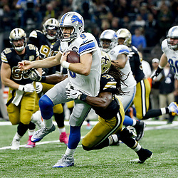 Dec 4, 2016; New Orleans, LA, USA; Detroit Lions quarterback Matthew Stafford (9) is tackled by New Orleans Saints outside linebacker Dannell Ellerbe (59) during the second quarter of a game at the Mercedes-Benz Superdome. Mandatory Credit: Derick E. Hingle-USA TODAY Sports