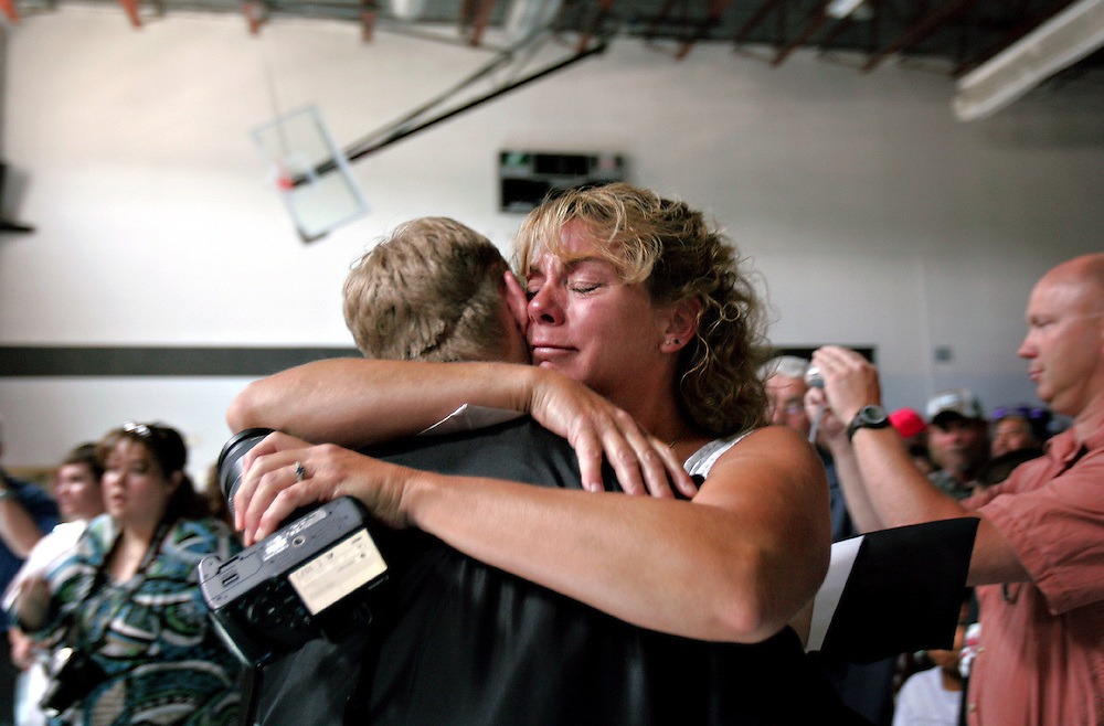 Xavier Mascareñas/The Daily Times; Cheryl Cadrain hugs her son, 18-year-old Vista Nueva Alternative High School graduate Micah Szumlinski, after the class' graduation ceremony at the Aztec, N.M., Boys and Girls Club on May 16, 2009.