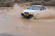 Israel, Negev Desert, a flash flood washes away the road