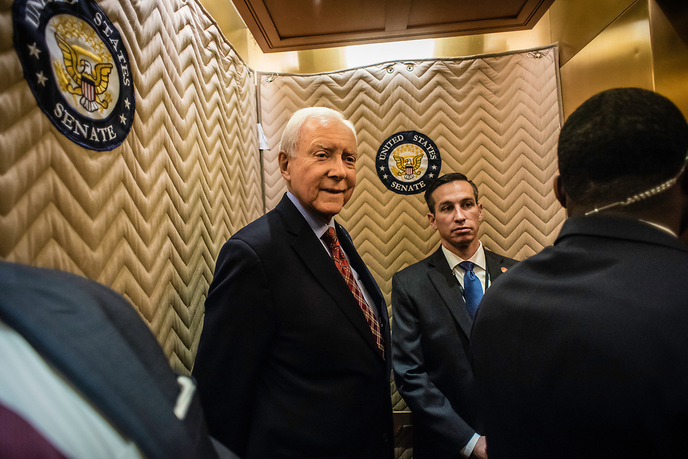 WASHINGTON, DC -- 12/21/17 -- Flanked by his security detail, Sen. Hatch makes his way to a luncheon. Senator Orrin Hatch is the senior senator from Utah, Chairman of the Senate Finance Committee and President pro tempore of the United States Senate..…by André Chung #_AC18050