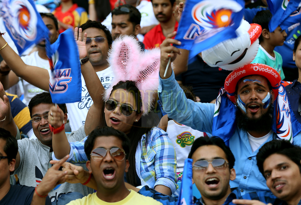 Fans Enjoys during match 5 of the Pepsi Indian Premier League Season 7 between the Royal Challengers Bangalore and the Mumbai Indians held at the Dubai International Cricket Stadium, Dubai, United Arab Emirates on the 19th April 2014<br /> <br /> Photo by Sandeep Shetty / IPL / SPORTZPICS