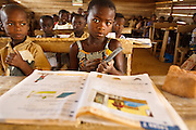 A girl sits at her desk during class at the Podio primary school in the village of Podio, Bas-Sassandra region, Cote d'Ivoire on Friday March 2, 2012.