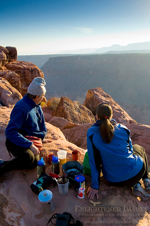 Tourist couple enjoying a camping breakfast, Toroweap, Grand Canyon National Park, Arizona - AVAILABLE FOR EDITORIAL USE ONLY.